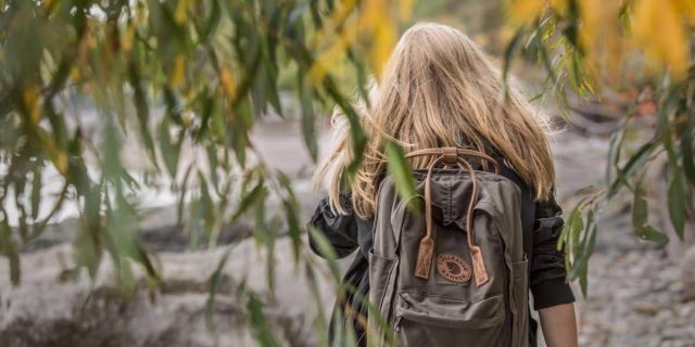 Girl with backpack bug out